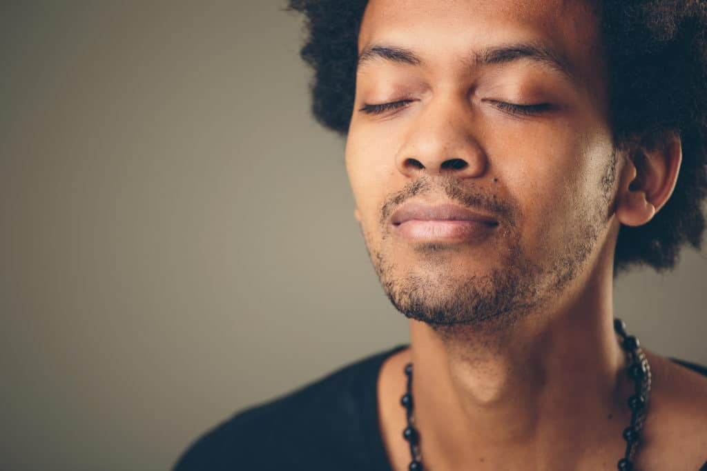 Man breathes deeply checks in with feelings