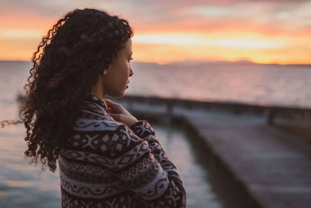 Woman Looks to Ocean with hope