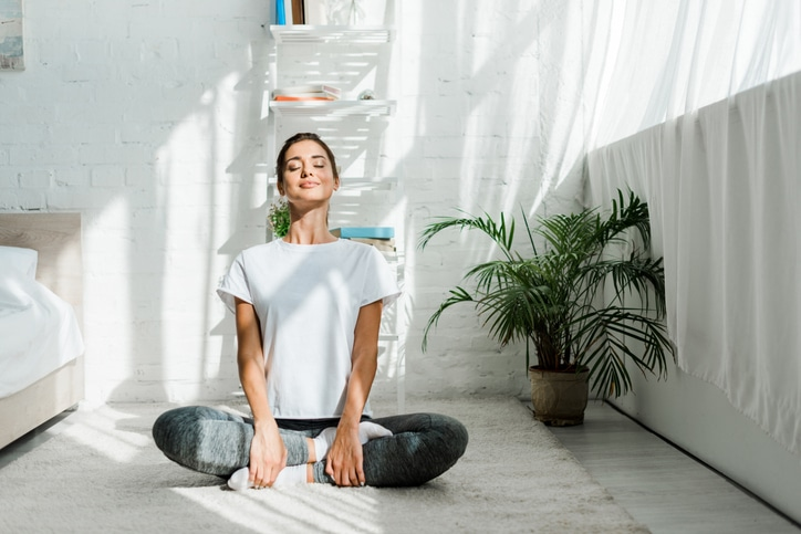 adult woman meditating in the morning
