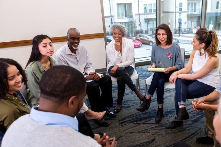 diverse group of people in group therapy