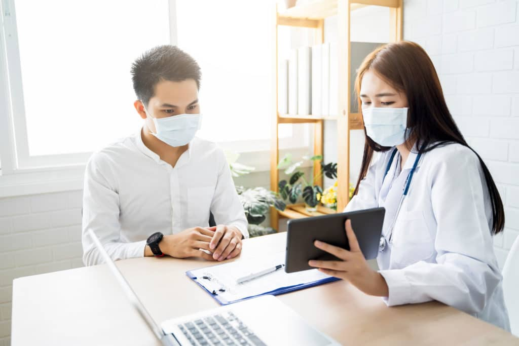 doctor discusses lab results with patient