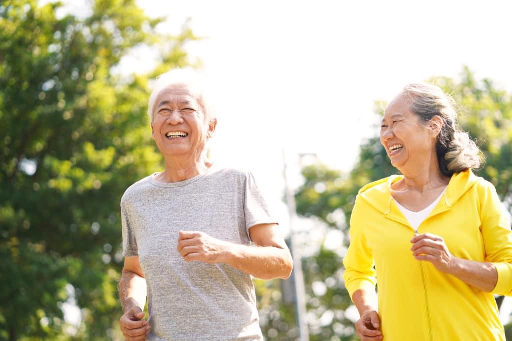 elderly couple walks together for mental health