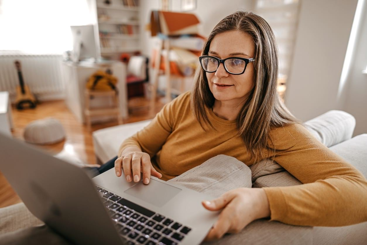woman working from home on the sofa