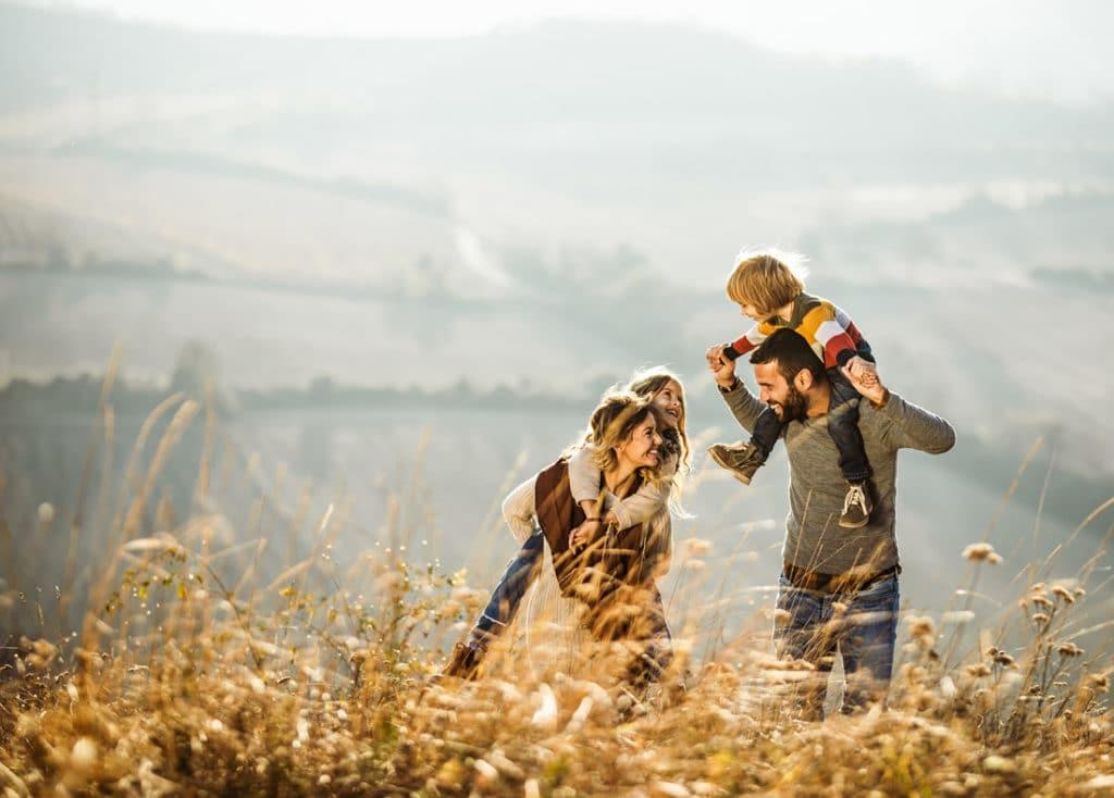 Happy family in a wheat field
