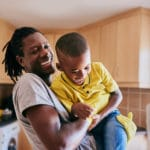 man raising his son with a health self esteem
