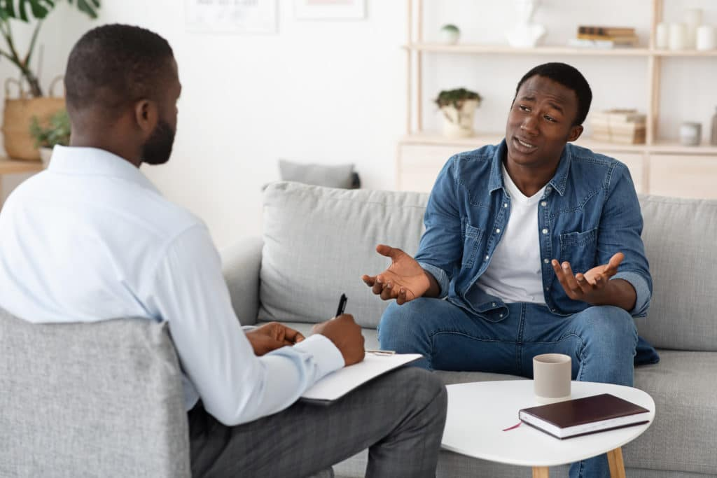 man talks to therapist about medication
