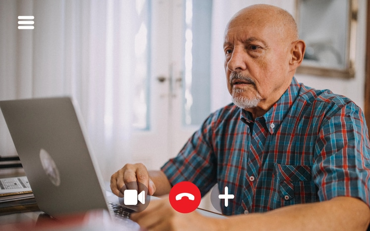 older man on online psychiatry appointment