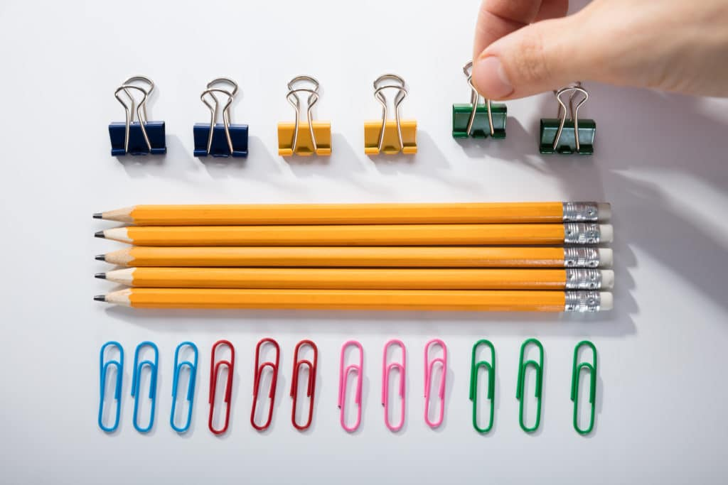 person neatly organizes office supplies