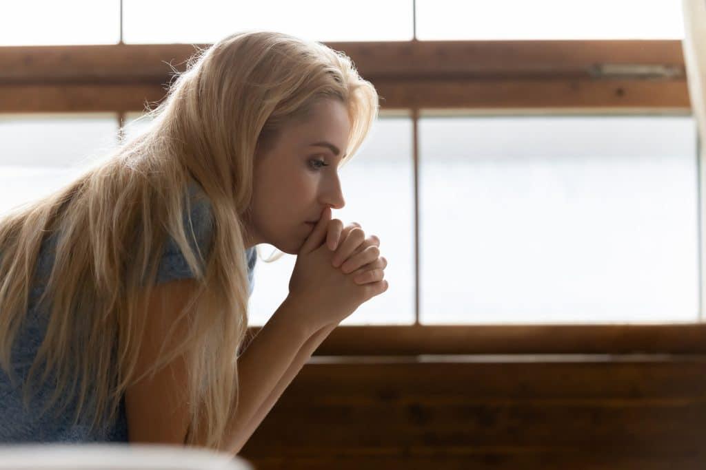 side shot of woman thinking