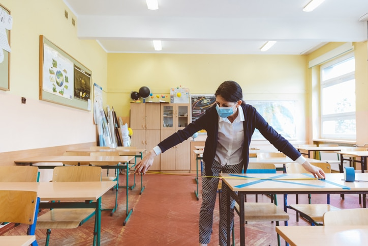 teacher taking safety procautions in her classroom
