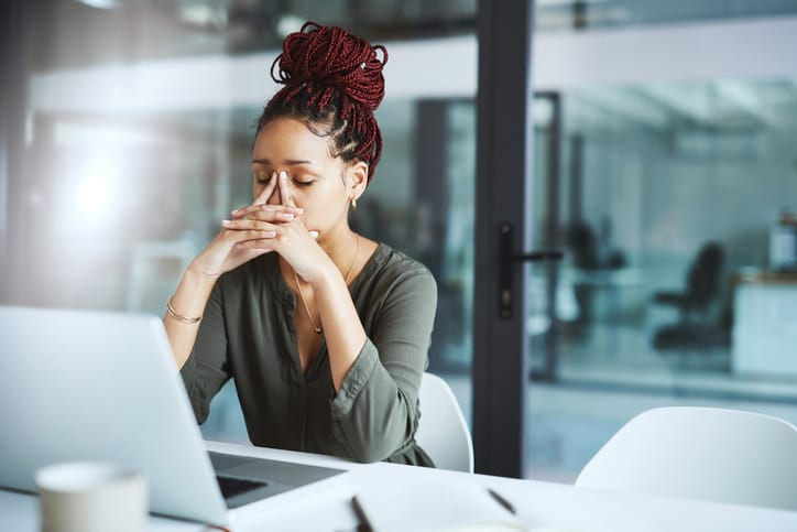 woman feeling stress while at work