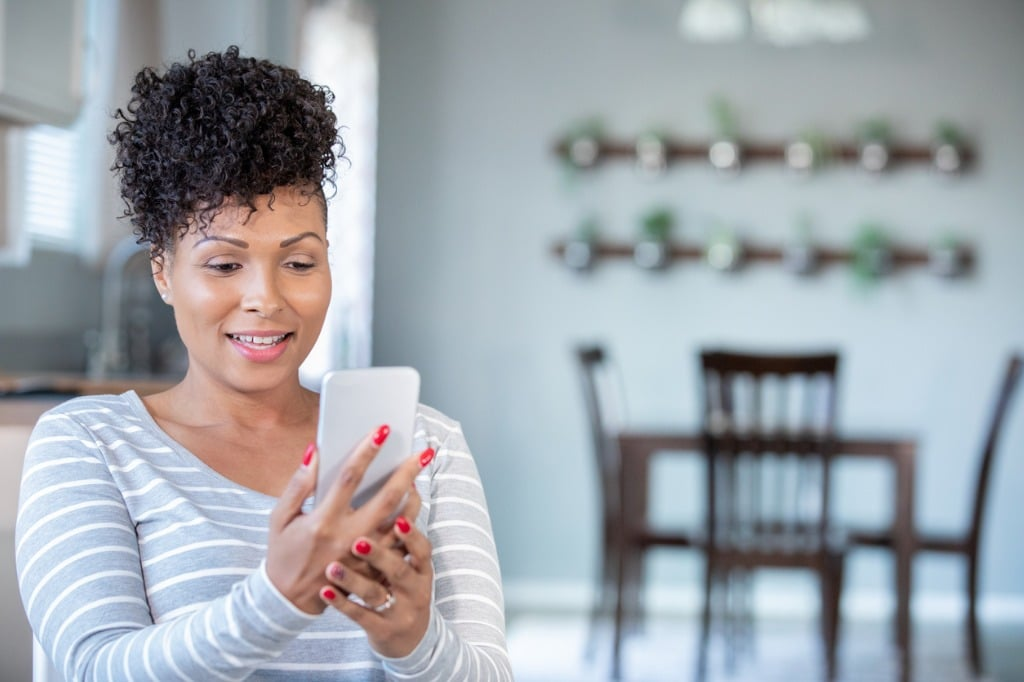 woman on telehealth appointment with therapist