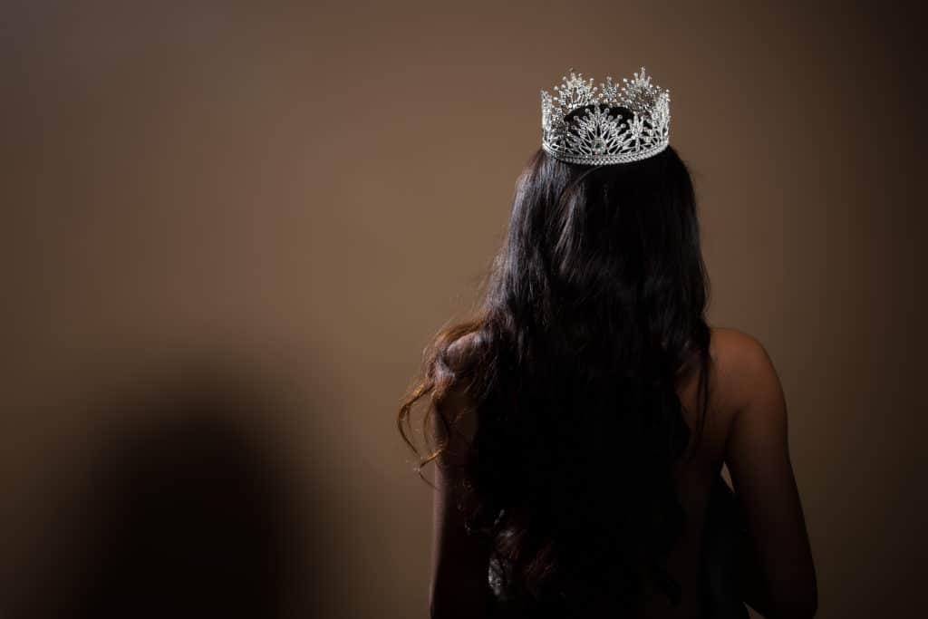 woman wearing crown facing away