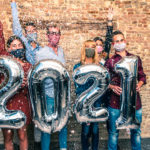 young adults celebrate 2021 with masks on
