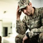 young military member feeling depressed